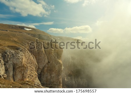 mountain plateau in a mist - stock photo