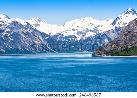 Mountain range and ocean waters in Glacier Bay National Park, Alaska - stock photo