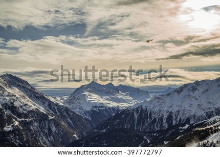 Mountain Range At Solden. Snowy Alps and a helicopter in Solden - stock photo