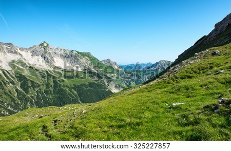 Mountain Range of the Alps as seen from the Fuchsen saddle near Hochvogel, Tyrol, Austria - stock photo