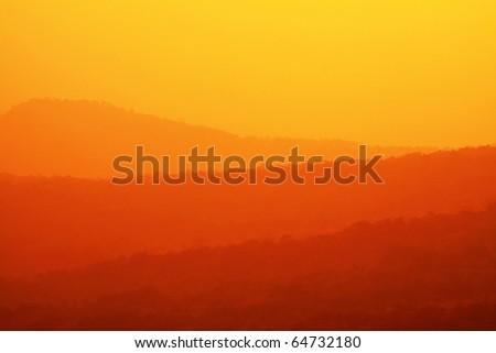 mountain range sunset - stock photo