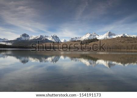 Mountain Reflection in smooth lake water Landscape mountain range - stock photo