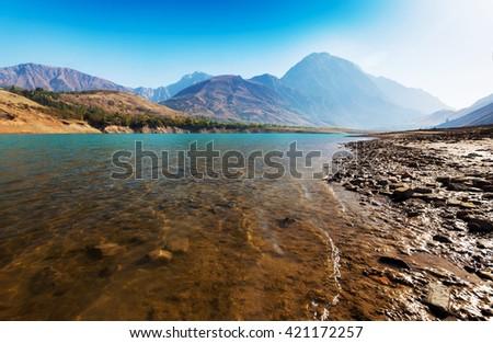 Mountain reflection on lake at sunrise, - stock photo