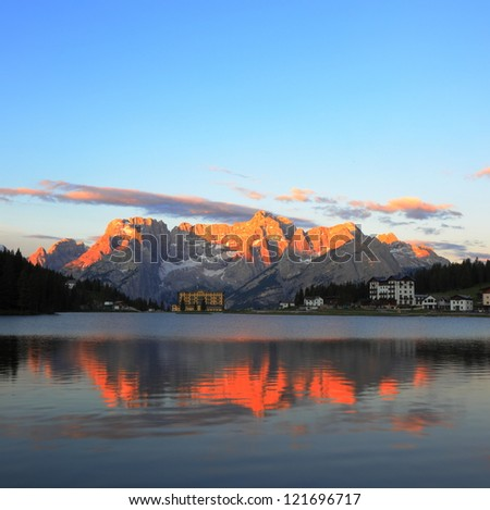 Mountain reflection on the lake Misurina, Italy - stock photo