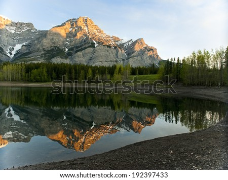 Mountain reflection on Wedge Pond at dawn - stock photo