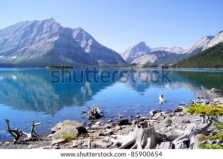 Mountain reflections in a cool blue lake in the Canadian Rockies - stock photo