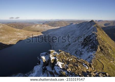 mountain ridge at sunset - striding edge, helvellyn, cumbria - stock photo