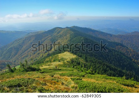 Mountain ridge pathway to the horizon - stock photo