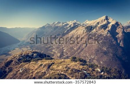 Mountain ridge with grassy slopes. Alpine ridges rising Bovec in Slovenia. - stock photo