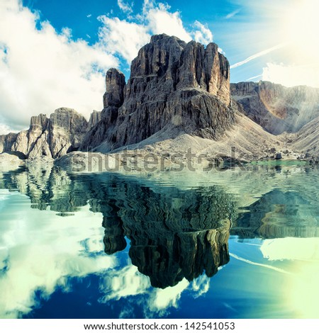 mountain river at morning sun with nice weather - stock photo