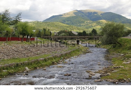 mountain river flowing in summer - stock photo