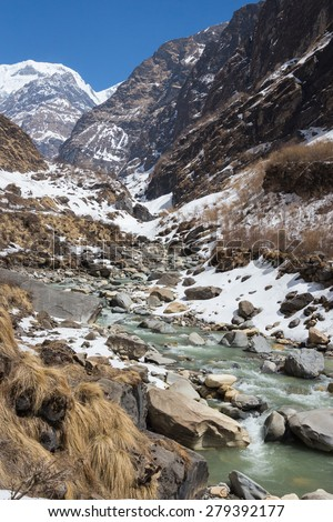 Mountain river on the track to the base camp of Annapurna - stock photo