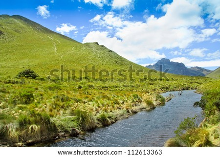 Mountain, river with blue sky and  clouds - stock photo