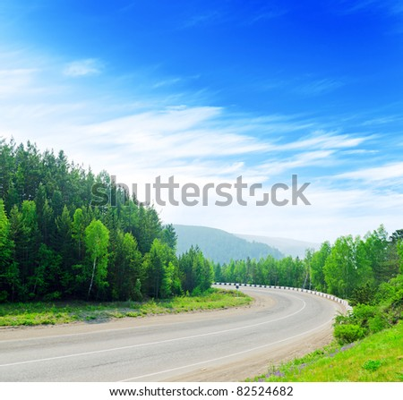 Mountain road and blue sky. - stock photo