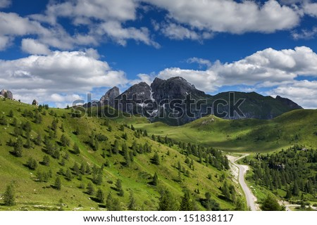 Mountain road and majestic views of the Dolomites - Italy. - stock photo