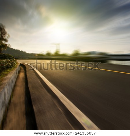 Mountain road at dusk - stock photo