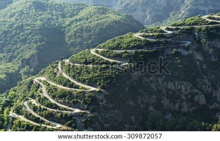 Mountain road at Pindos mountains of Epirus region, in Greece at sunset - stock photo