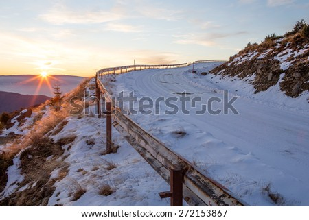 "Mountain road, covered in snow, on the ""Mic"" Mountain, in Romania - stock photo"