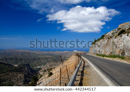 Mountain road. Fence of the grid. Crete, Greece - stock photo