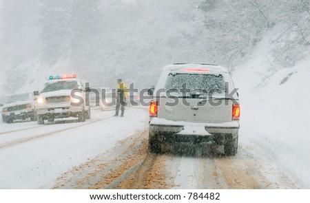 Mountain road in snow storm, Utah - stock photo