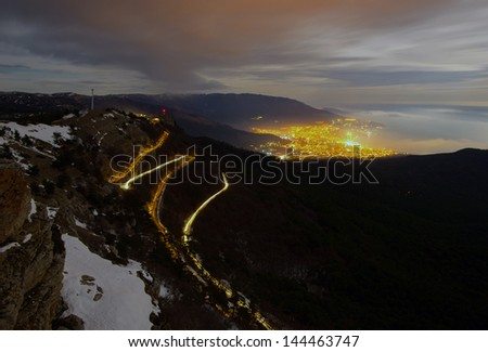 Mountain road in the night - stock photo