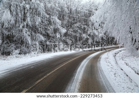 Mountain road in winter - stock photo