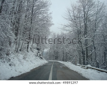Mountain road on winter - stock photo