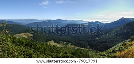 mountain scenery in Carpathians with lonely houses - stock photo