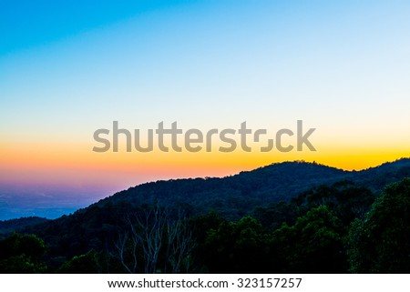 Mountain Silhouette with Sunset Time at Chiangmai Province, Thailand. - stock photo