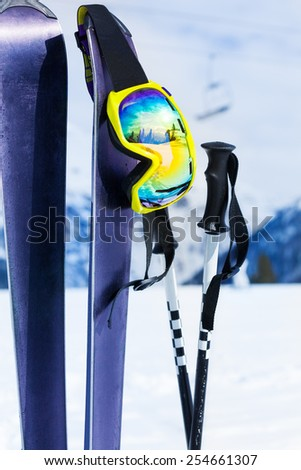 Mountain ski equipment close-up with mask and pole - stock photo