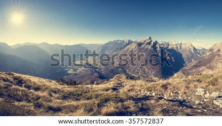 Mountain slope rising above a valley. Panoramic view. - stock photo