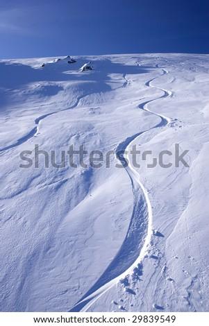 mountain snow snowboarding summit top tracks in the snow speed recreation blue sky vertical skiing ski resort - stock photo
