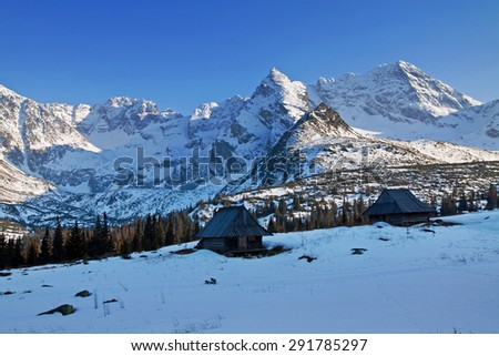 Mountain snowy landscape with wooden house shelter in Zakopane - stock photo