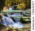 Mountain stream among the mossy stones, Erawan waterfall, Thailand - stock photo