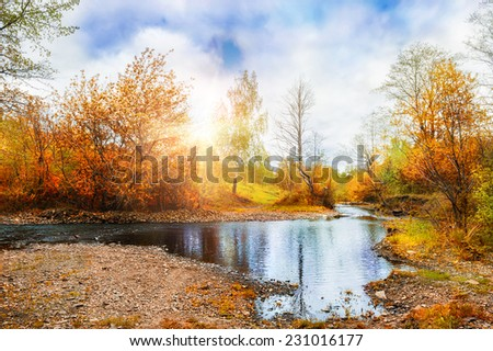 Mountain stream, forest autumn landscape at sunset. South Ural, Russia. Creative toning effect - stock photo