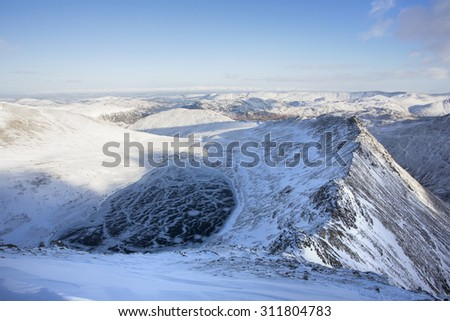 mountain summit view in winter with snow and ice covered ridges, helvellyn, cumbria - stock photo