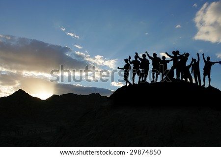 mountain sunrise silhouette people - stock photo