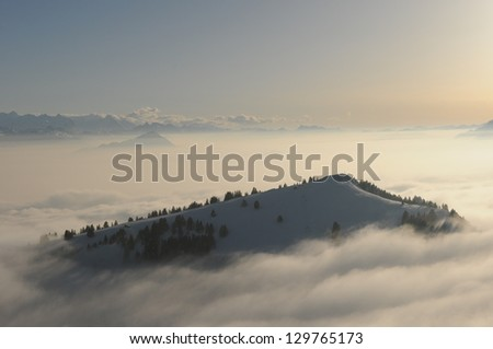 Mountain surrounded by clouds, in Switzerland - stock photo