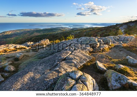 Mountain Top View of Sunset Along Coastline - stock photo