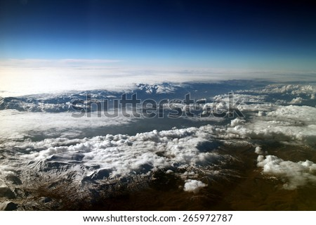 mountain topped with clouds - stock photo