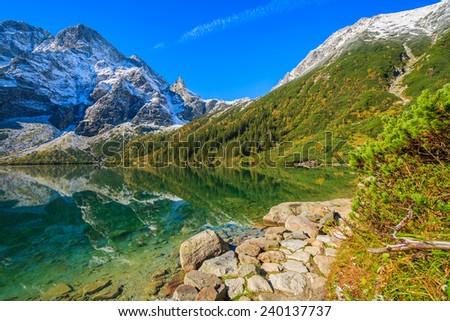 Mountain trail along Morskie Oko lake in autumn season, Tatra Mountains, Poland - stock photo