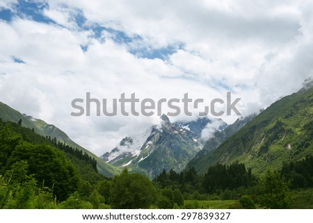 Mountain under blue sky with clouds - stock photo