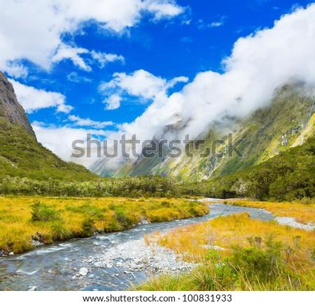 Mountain valley on the way to Milford Sound - stock photo
