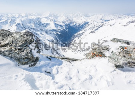 Mountain valley seen between two boulders, Ankoge, Austria - stock photo