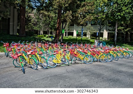 MOUNTAIN VIEW, CA - AUGUST 1, 2015: Bikes used by Google employees to navigate Google headquarters, also known as Googleplex, in Mountain View, California on August 1 2015 - stock photo