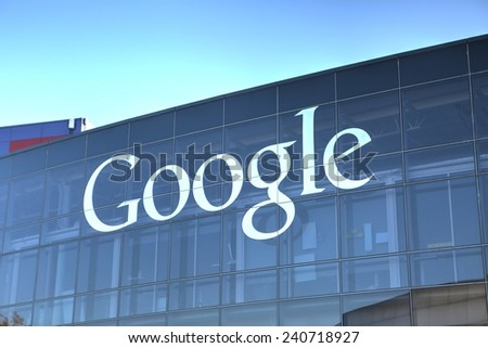 MOUNTAIN VIEW, CA/USA - December 28, 2014: Google sign on one of the Google headquarters buildings. Google is a multinational corporation specializing in Internet-related services and products. - stock photo
