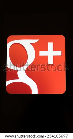 MOUNTAIN VIEW, CA/USA - NOV 17, 2014: Closeup photo of Google plus icon on a mobile phone screen. Gmail is a social networking service by Google. - stock photo