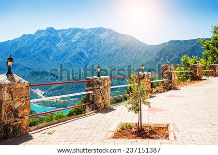 Mountain view from the terrace at sunset. Beautiful summer landscape - stock photo