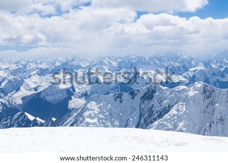 Mountain view  from the top of Lenin Peak in Pamir region, Kyrgyzstan - stock photo