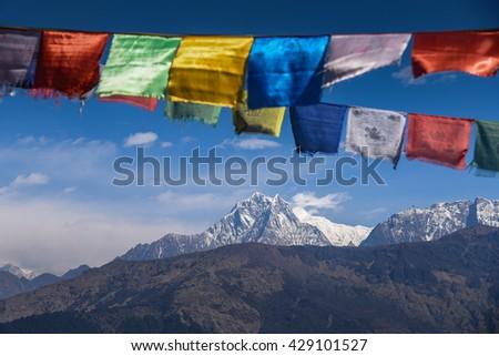 mountain view of Annapurna range (part of Himalaya) and Buddhist prayer flags, Nepal - stock photo